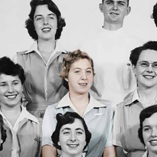 Velma Russ Reichenbach is surronded by classmates in 1954