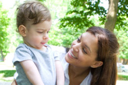 Alison Liddle (right) with a pediatric client in an outdoor setting.
