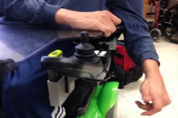 Closeup of equipment modification on arm of wheelchair