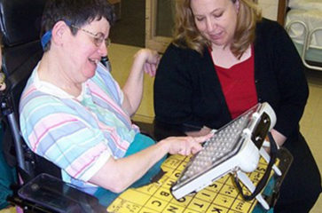 Two women using communication board
