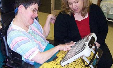 Two women using communication board