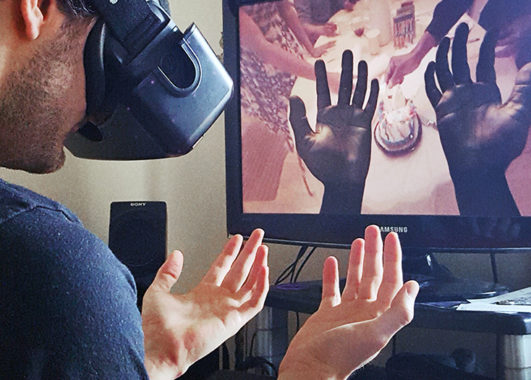 A We Are Alfred virtual reality user is looking at his hands through a headset that transforms him into a 74-year-old medical patient named Alfred