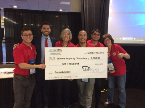 HIM students and faculty holding prize check for winning AHIMA16 Jeopardy competition