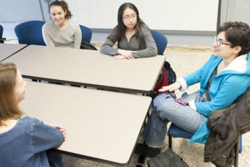 Group of students meeting together at a table