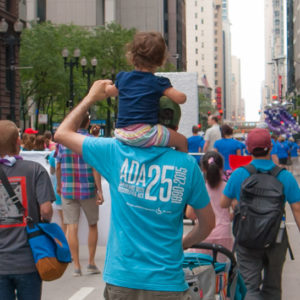IDHD faculty Brian Grossman with his daugther at the 2015 Chicago Disability Pride Parade