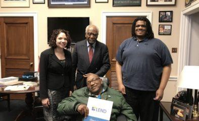 Three trainees with Representative Danny K. Davis