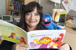 Sandy Magaña with Sesame Street book