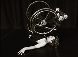 Woman on wheelchair performing a dance routine. Photo by Britten Traughber