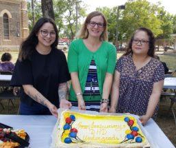 Academic staff with undergrad anniversary cake