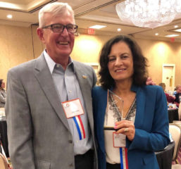 Tony Paulauski, the award's namesake, standing with Tamar Heller holding the award at the conference