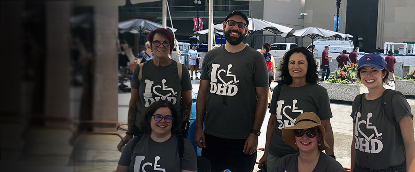 a group of people at a fair wearing IDHD shirts