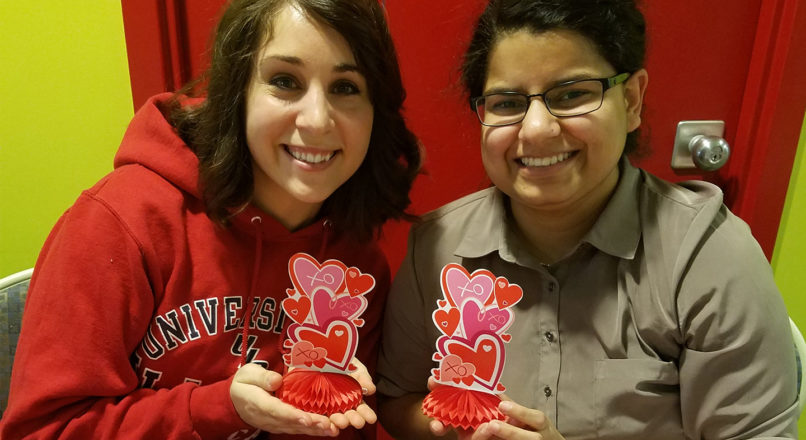Nutrition students Renee Jeffrey and Urooj Riaz selling baked goods during SNA's Valentine's Day Bake Sale