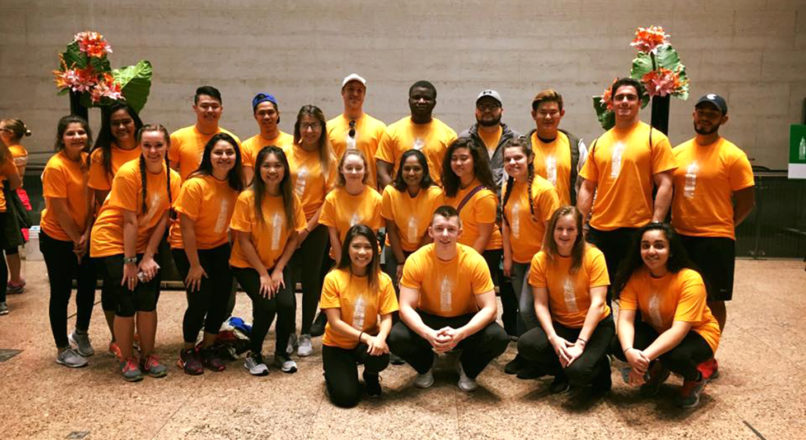 A large group of pre-PT students wearing yellow shirts