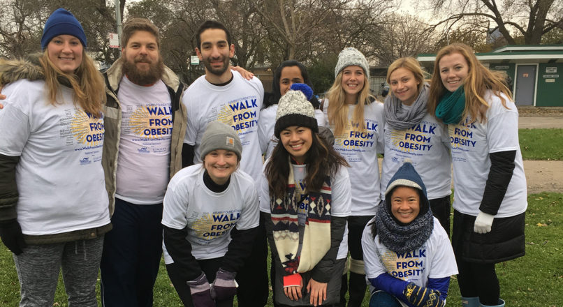 Doctor of physical therapy students and PT adjunct professor Richard Severin pose for photo wearing Walk From Obesity t-shirts