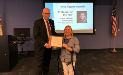 Dean Fernhall presented Carrie Sandahl with award certificate