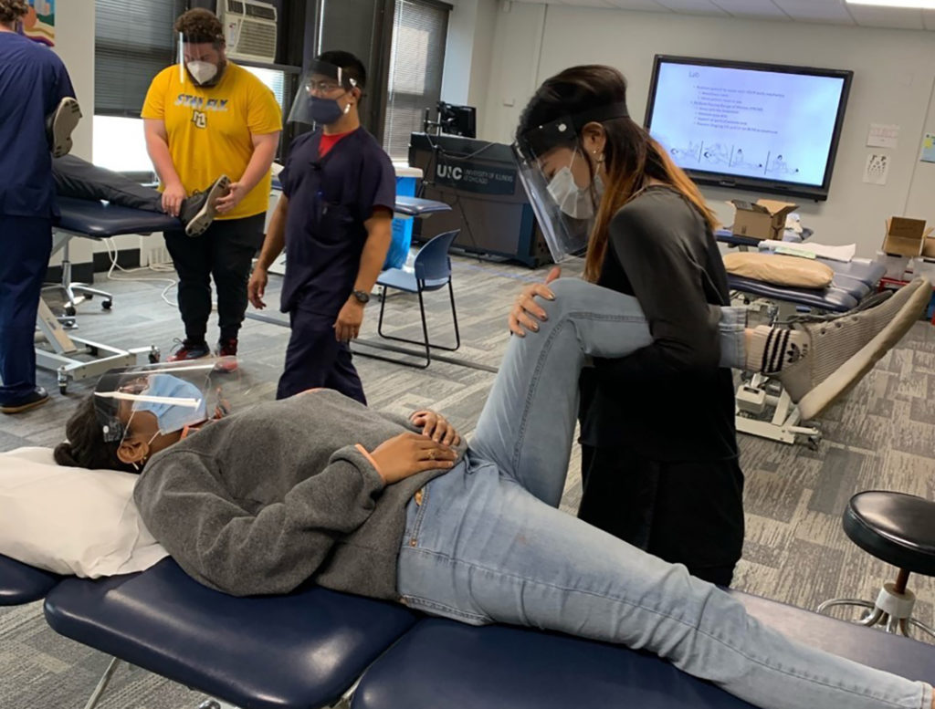 First-year DPT students participate in a bed mobility and body mechanics lab