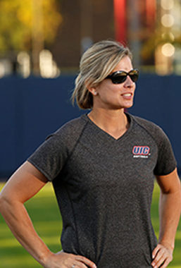 Lynn Curylo looks on to the field while wearing sunglasses