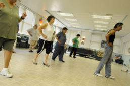 A group of seniors participating in a dance class led by an EPL instructor