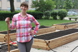Garden director Renea Solis, clinical instructor, in front of the new garden