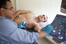 Mohamed Ali, PhD student, administers ultrasound to fellow PhD student, AJ Rosenberg
