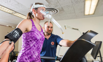 woman with breathing apparatus on treadmill