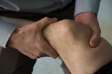Man manipulating knee
