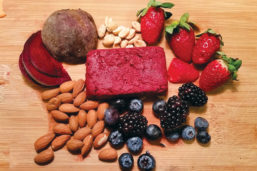 Nuts and berries on a wooden surface
