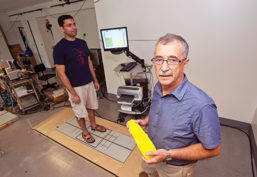 Physical therapy professor Alexander Aruin working in lab on shoe insole