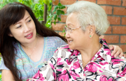 A middle-aged woman embraces an older woman while looking at one another