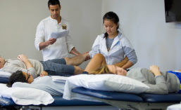 Physical therapy students learning manipulation